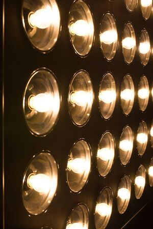 Vintage incandescent bulbs in retro style. Many lights in the form of a spotlight. Stock Photo