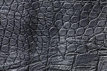 Close-up of a black leather texture background. Banco de Imagens