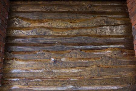 Decorative wall of pine boards painted with varnish. Wood texture.