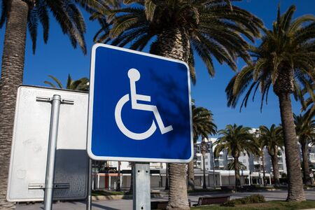 Sign for disabled parking close-up. A clear sunny day.