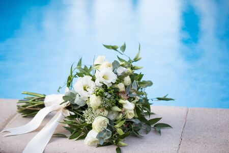 Wedding bridal bouquet on a blue background close-up.