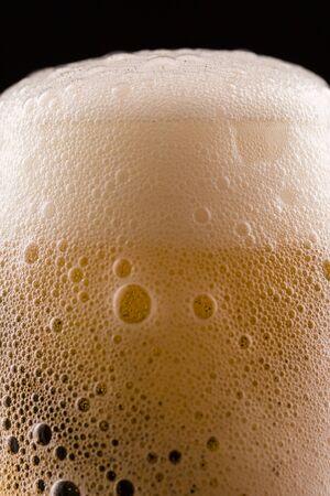 Beer foam texture closeup. Macro shot of a beer drink.