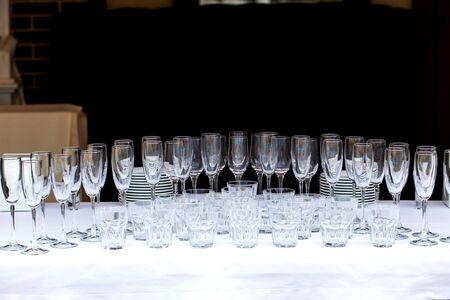 Glasses of champagne at a party or wedding celebration. The waiter pours champagne close-up.
