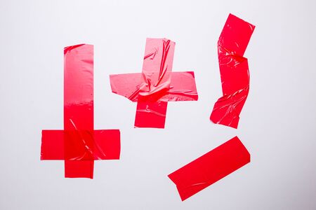 Set of adhesive tape in red on a white background close-up.