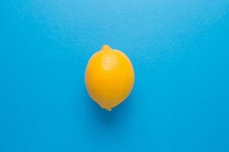 Lemon on a blue isolated background. Immunity protection for viral diseases.