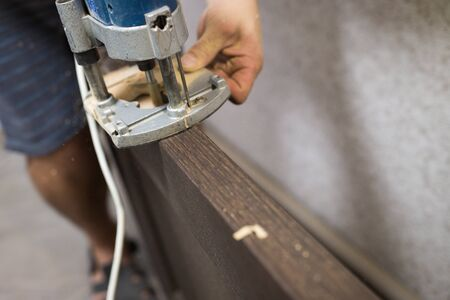 Milling manual machine close-up. The process of installing the front door. Stock fotó