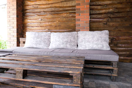 Furniture from pallets in the gazebo. Sofa and table in the barbecue lounge area.