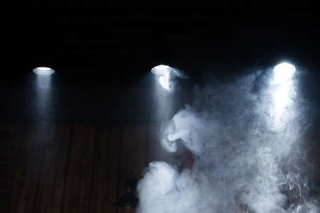 Lamps of light with a cloud of smoke. Close-up.