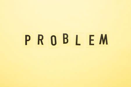 PROBLEMS inscription on a yellow background close-up. 版權商用圖片