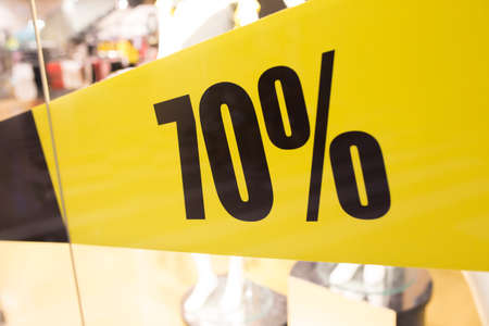 Discount 70 percent off. Inscription in black numbers on a yellow background.