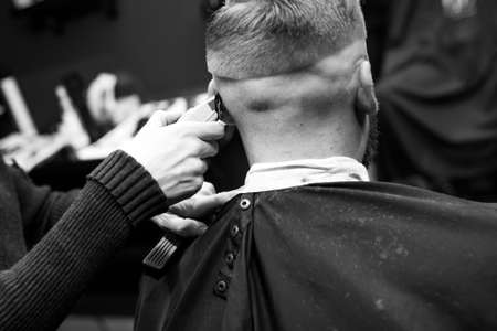 Haircut men typewriter close-up. Barber cuts a man.