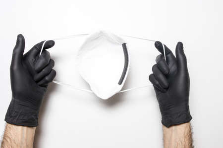 Male hand in a medical glove with a vaccine on a white background.