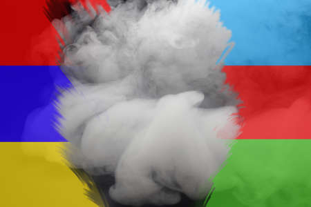 Armed conflict Armenia and Azerbaijan. Flags of Armenia and Azerbaijan in the smoke. Stock Photo