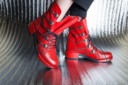 Red womens autumn boots close-up