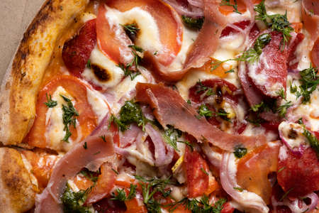Delicious juicy pizza close-up. View from above.