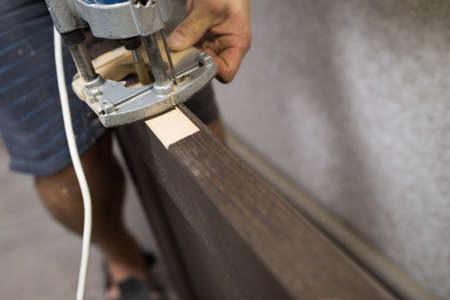 Milling manual machine close-up. The process of installing the front door. Фото со стока