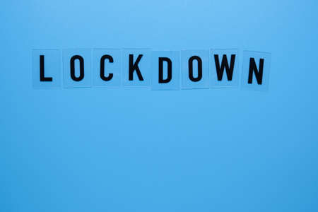 The word lockdown on a blue background close-up.
