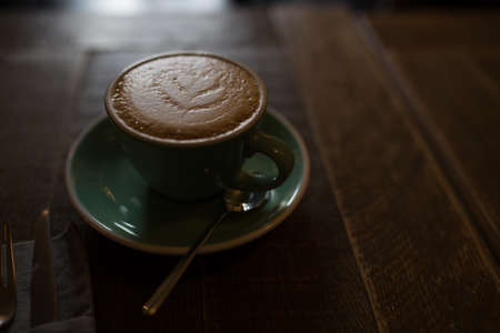Cappuccino on wood background