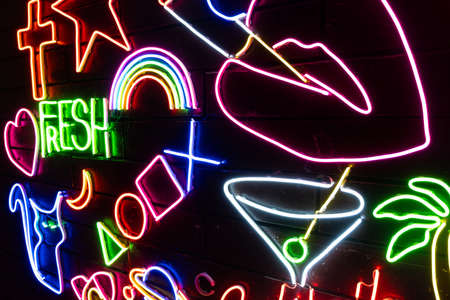 Neon assorted shapes on a black wall. Glowing multi-colored neon. Stock fotó