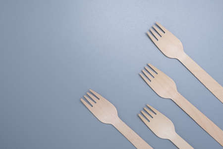 Wooden disposable fork on a gray background close-up. Environmentally friendly product. Stock fotó