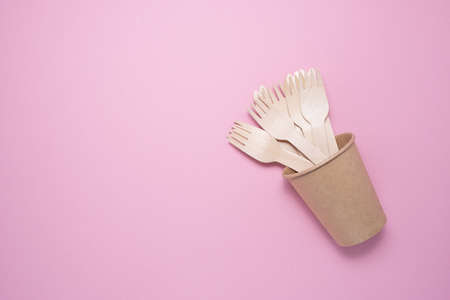 Wooden and cardboard disposable tableware on a gray background. Environmentally friendly products. Stock fotó