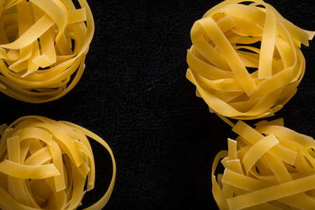 Italian pasta on a black isolated background close-up. Stockfoto