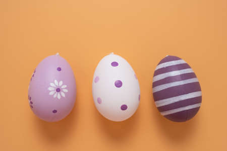 Colorful Easter eggs with different patterns as background, top view