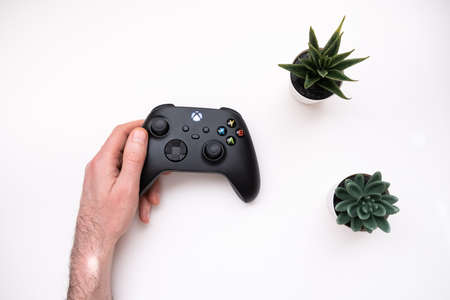 Joystick controller for playing on the new xbox series x console. Kiev, Ukraine - April 21, 2021 新聞圖片