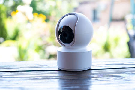 Video surveillance equipment on the table. Compact security camera for outdoor or private home security Stock fotó
