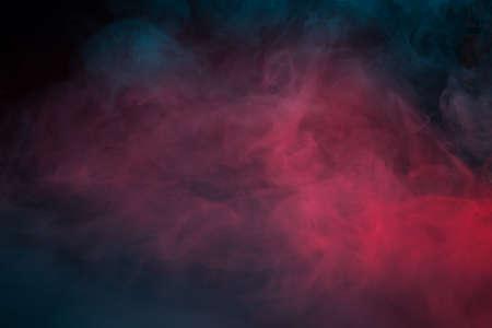 Colorful smoke on a black background closeup