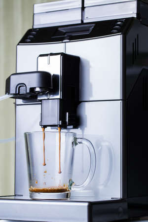 Automatic coffee machine with coffee in a transparent cup Stock fotó
