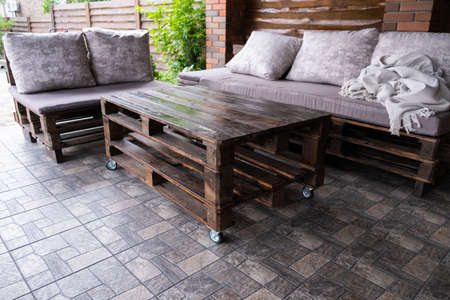 Furniture from pallets in the gazebo. Sofa and table in the barbecue lounge area