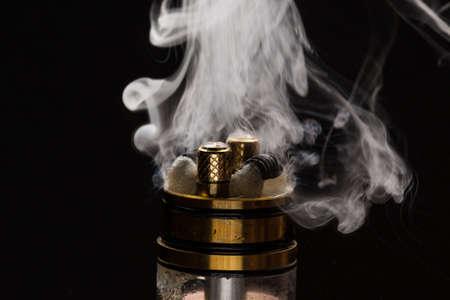 Vape close-up with smoke on a black background