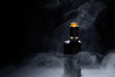 vape close-up in a smoke on a black background