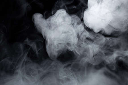 Texture of cigarette white smoke on a black background