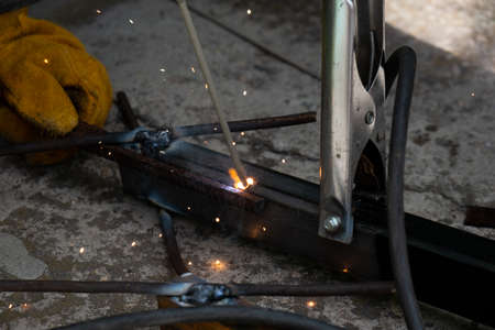 Welding work outdoors in a private house close-up.