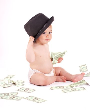 Business baby boy with money on white background