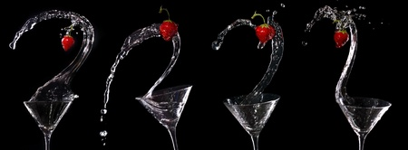 Martini strawberry splash on black Stock Photo