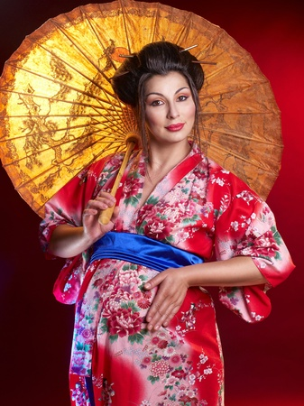 Beautiful pregnant geisha with umbrella