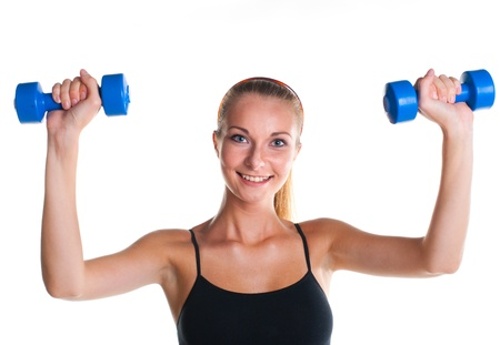 smiling young girl doing fitness exercises photo