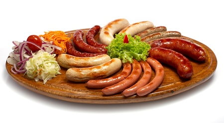 a set of different sausages, grilled on wooden plate Stock Photo - 12578631