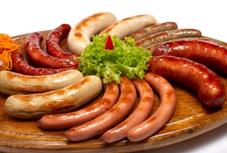 a set of different sausages, grilled on wooden plate photo