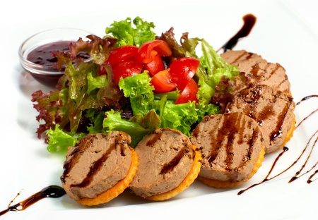 cracker with pate and salad Imagens