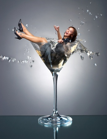 martini splash: Smilng girl fall in martini glass