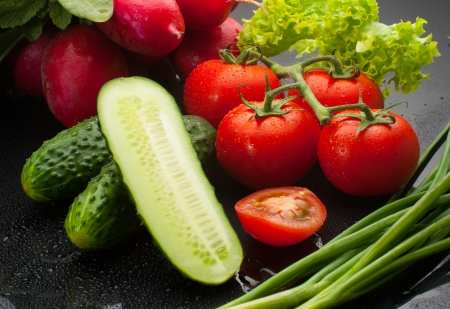 Assorted vegetables on black Stock Photo