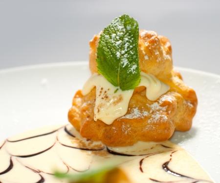 bigne: Bigne stuffed with pastry cream Stock Photo