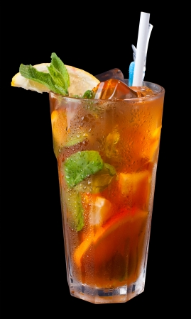 ice tea with citrus and mint on black
