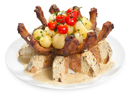 Delicious roasted pork with potatoes and tomato