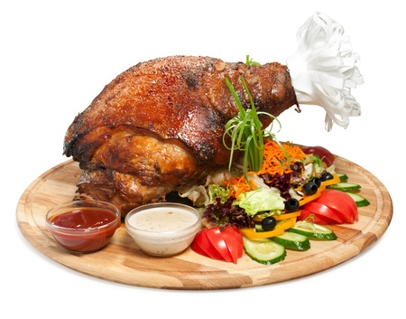 Delicious roasted pork leg with with vegetables photo