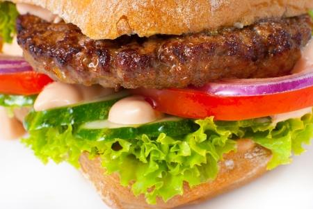 Sanwich with hamburger and vegetables macro shot